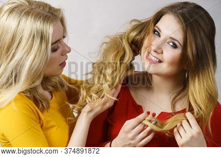 Woman Excited Looking On Her Female Friend Long Ombre Color Hair. Hairdo Colors, Haircare And Hairst