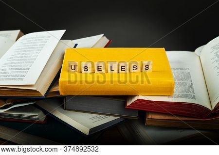 The Concept Of Useless Knowledge. Useless - Word From Wooden Blocks
