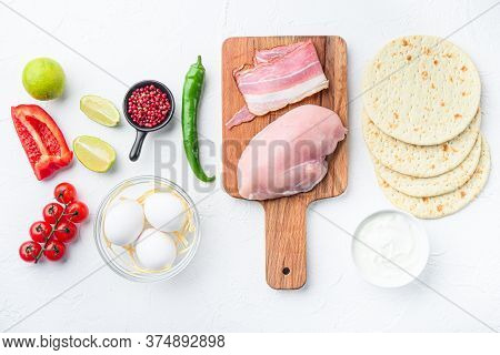 Ingredients For Chicken Tacos, , Tomatoes, Corn, Egg, Pepper,lime Chicken Meat And Tortillas Over Wh