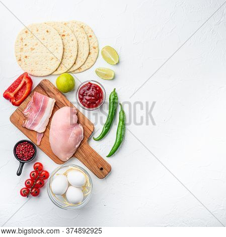 Mexican Tacos With Vegetables And Meat Ingredient For Cooking Over White Textured Background, Top Vi