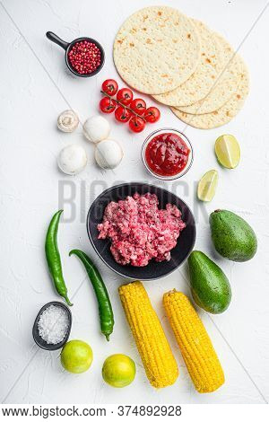 Taco Ingredients Homemade Authentic Mexican Beef Meal, Over White Concrete Background Top View.