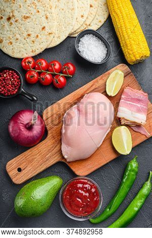 Ingredients For Mexican Tacos With Chicken Meat, Corn Tortilla, Salsa, Chilli Over Black Background,