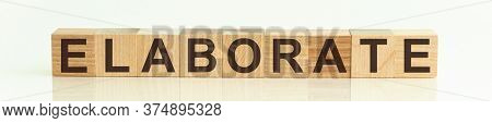 The Word Elaborate Written On Wooden Cubes Isolated On A White Background.