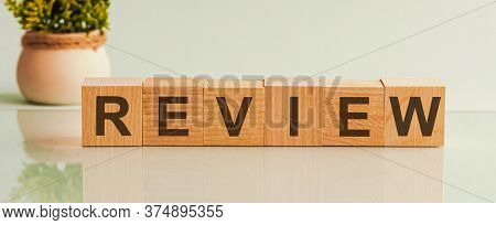 Wooden Blocks With The Word Review. Customer Review Concept. Service Rating. Feedback. Reviewing, Au
