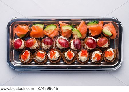 Mini Canapes With Smoked Salmon On Platter For A Party. Mini Canapes With Smoked Salmon Top View, Fl