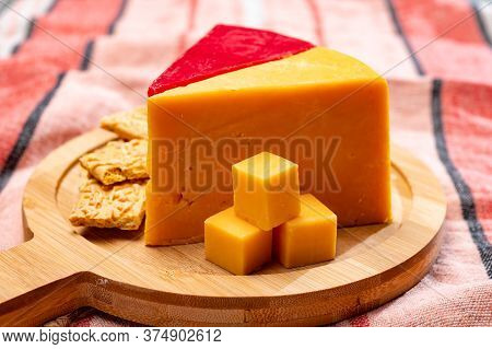 British Matured And Red Waxed Yellow Cheddar Cheese Close Up