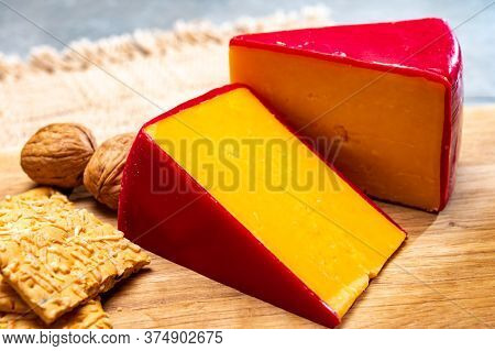 British Red Waxed Yellow Cheddar Cheese And Crackers With Grated Cheese