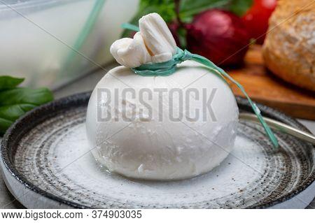 Eating Of Fresh Handmade Soft Italian Cheese From Puglia, White Balls Of Burrata Or Burratina Cheese
