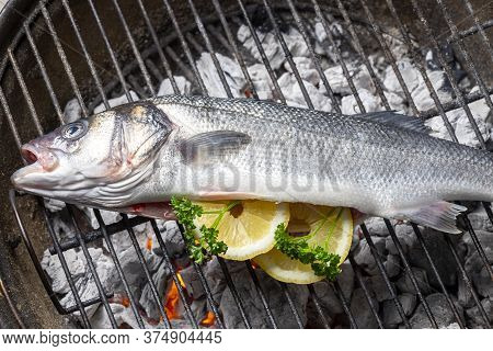 Bass With Lemon On The Bbq Grill