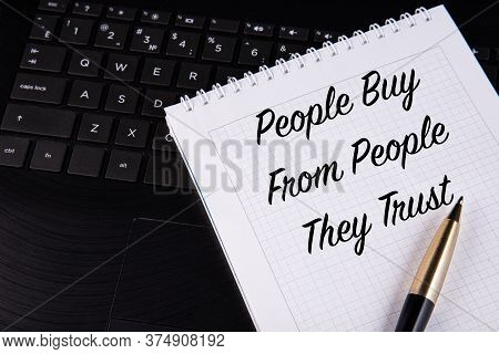 People Buy From People They Trust - Written On A Notebook With A Pen.