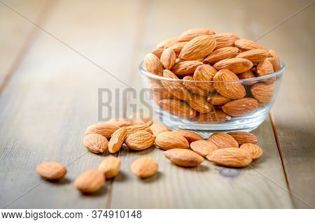 Almonds Nuts   Peeled In Glass Bowl On Wood Table. Almonds Are Very Popular Nuts And High Protein. H