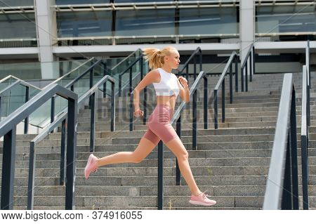 Run Like Beast, Look Like Beauty. Energetic Woman Run At Stadium. Fast Run. Fit Athlete In Sexy Spor