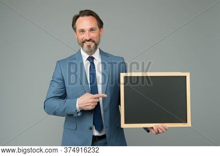For Sale. Happy Boss Pointing At School Blackboard. Ad Man With Pointing Gesture. Index Finger Point