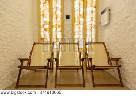 Three Deck Chairs In A Salt Bath Room.