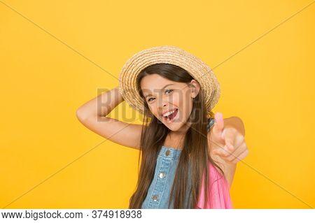 Smiling Kid In Straw Hat. Little Child Ready For Beach Activity. Happy Childhood. Joyful Summer Holi