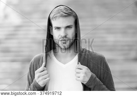 Perfect Male. Fashionable Young Model Man. Man Posing With Hoodie. Young Street Man With Hood. Incog