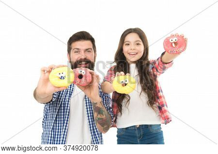 Sweet Tooth. Girl Child And Dad Hold Glazed Donuts. Cheerful Family. Sweets And Treats Concept. Daug