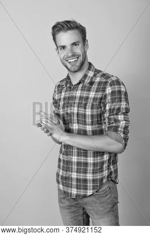 Menswear Shop. Macho Man Wearing Checkered Shirt. Fashion Summer Trends. Unshaven Man Skin Care. Bar