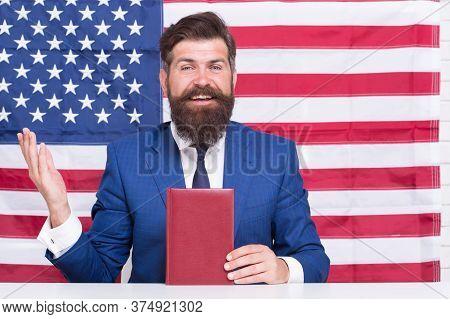 Student Visa. Visa Applicant Hold Book On American Flag Background. Diversity Visa. Usa Green Card L