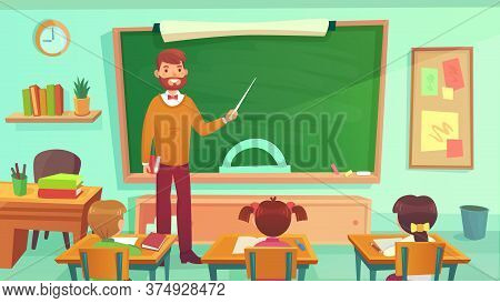 Male Teacher Teaches Students In Elementary School Class. Education Teacher Stay At Blackboard, Teac