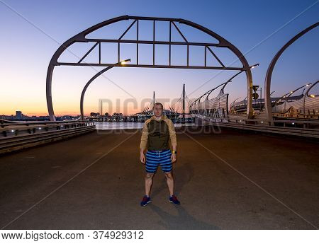 Saint-petersburg.russia.june 24, 2020.a Man On The Background Of The Gazprom Arena Stadium And The R