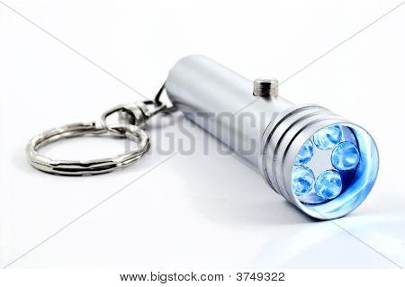 Silver Led Flashlight Isolated On White