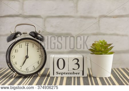 September 3 On A Wooden Calendar Next To The Alarm Clock.september Day, Empty Space For Text.calenda