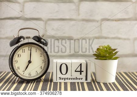 September 4 On A Wooden Calendar Next To The Alarm Clock.september Day, Empty Space For Text.calenda