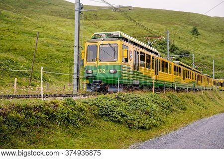 Lauterbrunnen, Berner Oberland, Switzerland - July 29 2019 : Yellow And Green Train Of Wengernalpbah