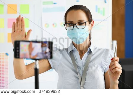 Business Woman In Protective Mask Say Hallo On Smartphone Camera Portrait. Business Online Education