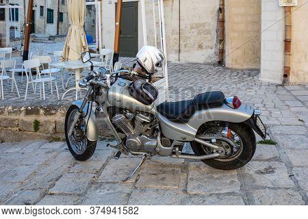 Matera, Italy - September 15, 2019: Honda Motorcycle Parked At A Cafe In The Sassi Di Matera A Histo