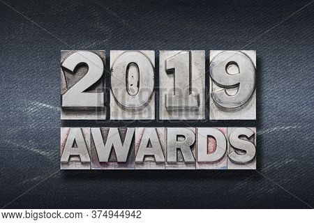 2019 Awards Phrase Made From Metallic Letterpress On Dark Jeans Background
