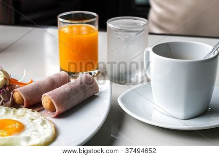Breakfast With Fried Eggs, Juice And Coffee