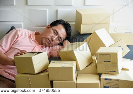 Asian Men Are Falling Asleep Because To Tired Of Handling The Order-based Goods From Online Customer