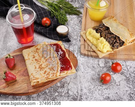 Shrovetide Maslenitsa. Traditional Festival Meal. Pancakes Blini With Meat And Berry Jam, Flat Lay B