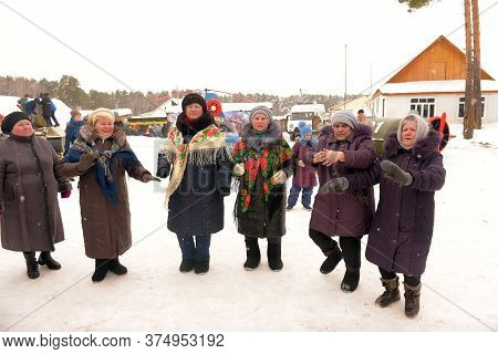 Elderly Women And Fellow Villagers Dance And Rejoice At The Village Holiday In Winter