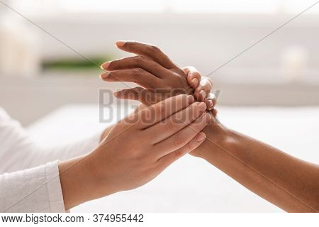 Hand Massage. Female Therapist Pressing Specific Spots On Black Lady Palm. Professional Health And W