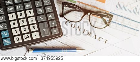 Business Concept With Calculator Glasses And Pencil On Documents. Business Grafs And Charts. Contrac