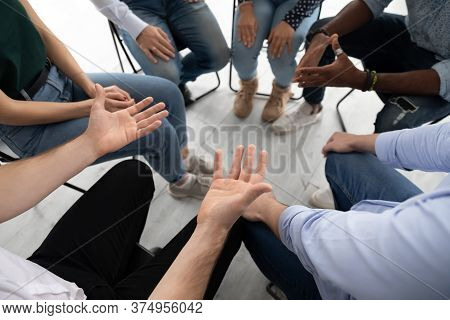 Participants Communicating During Corporate Teambuilding Or Rehab Group Session