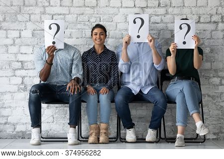 Applicant Sit With Competitors People Hiding Faces Behind Question Marks