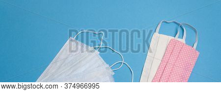 Five Beautiful Colored Different Medical Masks On Blue Isolated Background. Hygienic, Antimicrobial,