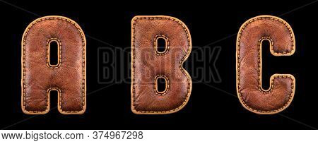 Set of leather letters A, B, C uppercase. 3D render font with skin texture isolated on black background. 3d rendering