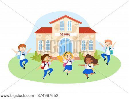 Happy Kids In School Uniform With Backpacks Jumping In School Yard. Schoolboys And Schoolgirls Chara