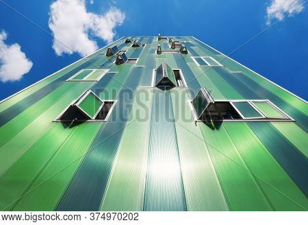 MADRID, SPAIN – MAY 13, 2018: A close look of a green apartment building in Madrid in Spain