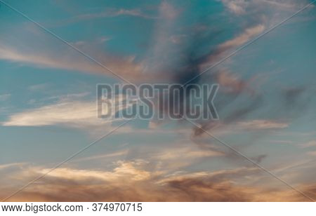 Bright Amazing Evening Sunset Sky With Feathery Clouds. Selective Focus