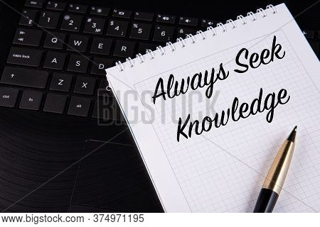 Always Seek Knowledge - Written On A Notebook With A Pen.