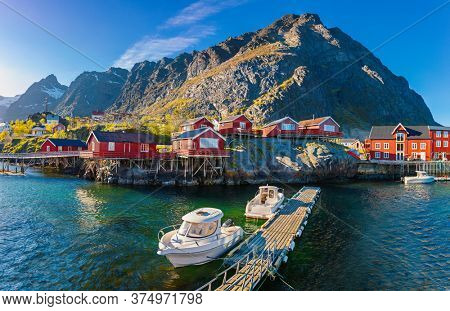 O Village, Moskenes,  Red Norwegian Rorbu, fishing huts on Lofoten islands, Norwegian traditional type of house used by fishermen