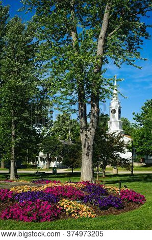 Beds Of Multi-colored Petunias Beautify The Township Square In Twinsburg, Ohio; A Historic Church Da
