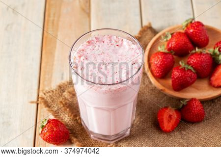 Fresh Milkshake With Strawberries. Summer Drink With Berries In A Glass On A Wooden Background.