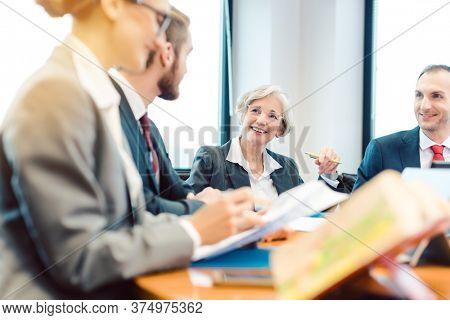 Lawyers working in team on a contract in their law firm